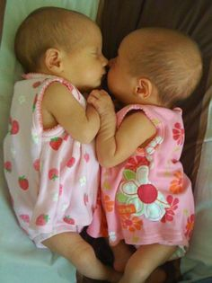 Identical twin girls......I just want to cuddle them right now!
