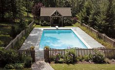 like this pool and little pool house...the fence is also very cute