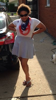 Outfit of the day is a gray skater skirt with a white short sleeve shirt, silver sandals and American flag scarf.
