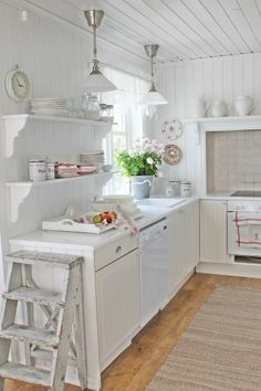 <3 I'm obsessed with this all white kitchen that has little touches of farm house chic and lots of vintage storage