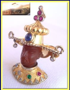 Signed, vintage Chinese Mandarin/Blackamoor pendant made of carved carnelian, diamonds, and gemstones, including emerald, ruby, sapphires set in 18k gold. (#3964)