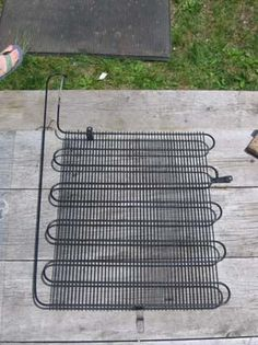 """This option is small-scale and it is built around a reclaimed heat dispersal system from an old refrigerator (which you can get with the gas removed from your local dump). It has no pump as it is gravity fed and it requires no electricity to work. Just put it in the sun, turn on the water feed and you will get a slow but constant supply of very hot water..."""