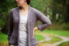 Lovely open cardigan for autumn days. It's warm, simple and easy with small details. The cardigan is worked from the top down in one piece.