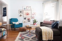 The living room is painted in Behr Streetwise. The sectional is Room & Board. The coffee table, end table and teal arm chair are from Article. Angela bought the living room rug from RugsUSA.
