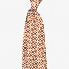 Printed silk tie with a micro pattern design. Features handrolled edges for a light and airy feel. Handmade for Berg&Berg in Como, Italy.