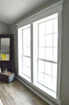 DIY Craftsman Window Trim is part of Living Room Windows And Doors - door trim that makes my heart melt I think it's the perfect way to add character to any space, but especially… Craftsman Window Trim, Interior Window Trim, Craftsman Houses, Craftsman Interior, Interior Shutters, Craftsman Style, Farmhouse Trim, Farmhouse Windows, Farmhouse Ideas