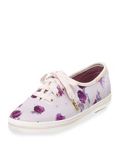 "kate spade new york floral-print cotton sneaker. 0.8"" flat heel. Round toe. Lace-up front. Logo patch stitched at tongue. Spade stud and Keds logo at back. Twill lining and cushioned insole. Rubber ou"