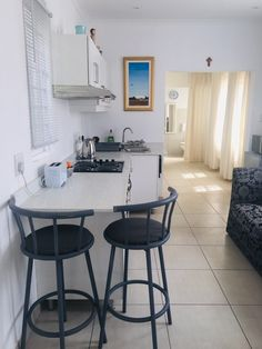 Lizzie's Garden Cottage Durban Microwave In Kitchen, Stove Oven, Wicker Chairs, My Property, Garden Cottage, Cupboard Storage, One Bedroom, House Rooms, Vacation Rentals