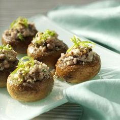"""Potluck Sausage-Stuffed Mushrooms Recipe -Pennsylvania is often referred to as the """"Mushroom Capital of the World."""" This recipe's a delicious appetizer and is always the hit of the party. —Beatrice Vetrano, Landenberg, Pennsylvania"""