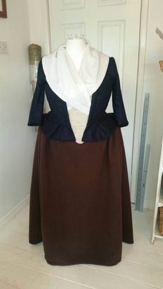 A hand made, made to measure replica of the everyday woolen gown worn by Claire Fraser in the 2015 TV series Outlander. Made to a professional standard out of quality english wool, linen and cotton. This gown is tailor made with a structured boned bodice with a laced up opening at the front and an over sized cotton bum roll. Finished off with a pleated brown cotton petticoat for shape and volume. Measurements for wearer: CUSTOM made to fit you! Customer is responsible for sending accurate…