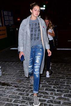Gigi Hadid wearing Vianel New York Iphone Case in Electric Blue, Adidas Yeezy Boost 350 Sneakers, Neon Rose Blanket Cocoon Coat and Blue & Cream Rapper Baby Tee in Gray