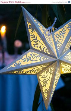 Paper Star Lantern with Floral Cutouts  by ExquisitePaperDesign, $3.99
