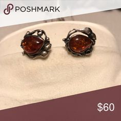 Beautiful Amber Stud Earrings in Sterling Silver Beautiful Amber Earrings in a Sterling Silver. Bought off QVC and never wore them. They are pretty. Excellent condition Jewelry Earrings