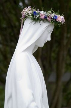 May day crowning...I remember the May procession well, my grade school classmates and I would walk around the church singing and singing and then the most popular girl (lol but true) got to crown the Virgin Mary statue with beautiful flowers...