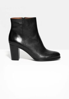 Smooth leather shapes these streamlined boots featuring a comfy ankle height and a lux zip closure on the inner side of the shaft.