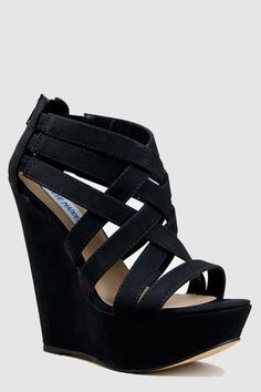 Black wedges -Steve MaddenI need shoes that resemble this. As long as the back of the heel is thicker than like an inch... No skinnier. 6 1/2 Steve madden is ALWAYS a good choice.