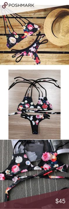 🆕the strappy tie halter bikini • style name: the strappy tie halter bikini • color: black floral • triangle style bikini w/ strappy halter ties at neck • no padding in cups - lined only • bottoms have minimal coverage, strappy side cutouts • please see sizing guide above • condition: brand new boutique item ____________________________________________________ ✅ make an offer!     ✅ i bundle! ✅ posh compliant closet ⛔️ no trades 🛍 boutique item Swim Bikinis