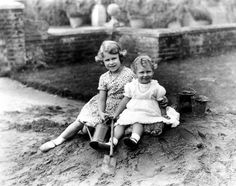 Princess Elizabeth, aged six, and Princess Margaret, aged two, playing in a sandpit at their grandparents' home in Hertfordshire.