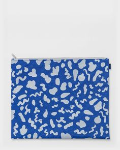 A large all purpose flat zip pouch. Makes a chic folder alternative for holding documents. Protect a notebook or sketchbook. Also great for organizing socks, un