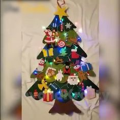 Last Day Promotion ⏰ - Having a tree is very hard for us because the kids touch it too much. This felt tree was great, finally a tree I could hang up and not worry about the kids/cats knocking it over or getting hurt Led Christmas Tree, Colorful Christmas Tree, Christmas Crafts For Kids, Christmas Projects, Christmas Tree Decorations, Holiday Crafts, Christmas Diy, Christmas Ornaments, Contemporary Christmas Trees
