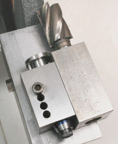 End Mill Sharpening Jig by Harold Hall -- Homemade end mill sharpening jig and rest intended for offhand use. Device features an integral feed screw. Components were machined from steel. http://www.homemadetools.net/homemade-end-mill-sharpening-jig