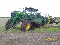 John Deere Spray Coupe Stuck In Field - TractorShed.com