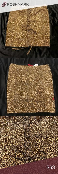 """Torrid Pin Up Girl Leopard Print Corset Back Skirt There's so much to love about this sexy little skirt! New With Tags, this Leopard Print Pin Up Girl Pencil Skirt by TRIPP NYC has corset lacing in the back to follow your curves. The bottom of the skirt is trimmed in black lace. Size 20. Length 24"""", Waist 22"""" across, Hip 23 1/2"""". TRIPP NYC Skirts Pencil"""