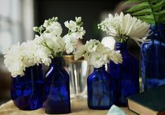 Cute center piece idea.Just gives us a reason/excuse to drink more bud light platinum and wine that comes in blue bottles! :)