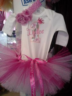 1st birthday outfit fit for a lil' princess,white long sleeve shirt with pink camo one and name customized with rhinestones and crown with handmade flowers made from the same tulle in tutu and a rhinestone crown on headband