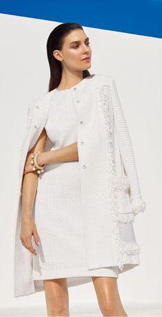 The quintessence of easy elegance, this St. John Zinmari knit topper boasts decorative tonal fringe trim for day to night drama.