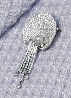 The Queen Mother's Shell Brooch (the official name is the Courtauld Thomsen Scallop-Shell Brooch).  It is in the shape of a scallop shell made of solid rows of diamonds with a single pearl cradled at the base & a fringe (strings of diamonds of varying lengths suspended underneath).  It was designed by Lord Courtauld-Thomsen & made in 1919.  It was left to Queen Elizabeth in 1944 by his sister, Winifred Hope Thomsen.