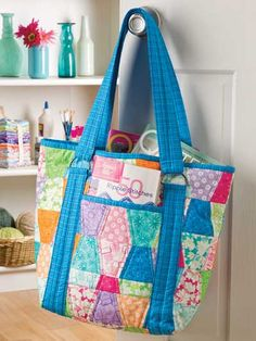 Tumbler Tote    Technique - Quilting    This roomy tote is a great project to use up scraps, and die-cutting those scraps makes construction a joy! Tailor the inside pockets to fit your personal needs. Make a tote to carry everything you need for the office, your quilt class, the pool or for Baby. This e-pattern was originally published in Quilted Curves & Strips With the AccuQuilt GO!®.