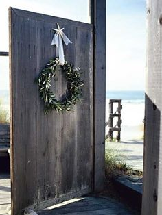 Wreaths are an easy way to add regional charm to your Christmas decorations, especially if you live in a mild coastal climate. Here, a dried sea star and a 3-inch-wide silver ribbon make natural complements to sprigs of olive leaves. Fine-gauge wire was used to attach overlapping stems to a wire wreath frame. (Photo: Photo: Jay Graham; Stylist: ; Designer:)