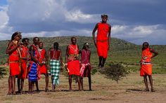 "A group of Maasai men showing their traditional ""jumping dance""."