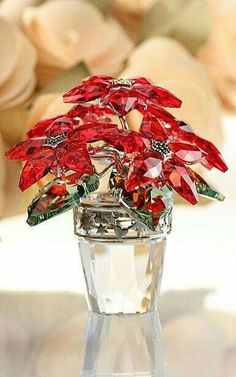 d7774ba4e The traditional Christmas colors of Light Siam and Peridot crystal sparkle  on this magnificent Poinsettia.