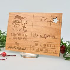 Show your child's teacher how appreciative you are of their hard work with our wooden postcard plaques. This is the perfect personalised gift to spread the Christmas love. Select from our designs or create your own design with a personalised message to make the perfect Christmas present. Our postcards are unique and not like any other Christmas gifts! We laser engrave onto honey brown wood and supply a clear acrylic stand for presentation. The teacher can have this displayed on their desk!