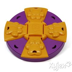 Kyjen 2405, Paw Flapper Treat Toy Dog Toy Scent Puzzle Training Toy, Large, Purple Kyjen,http://www.amazon.com/dp/B006ZTTSOE/ref=cm_sw_r_pi_dp_R0O6sb0R85NY0T8G