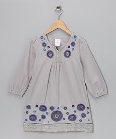 Treat girls to a breath of fun fashion with this cotton dress. With its delicate embroidery and slightly puffed sleeves, this piece slips over heads for a look that brings a dose of boho-chic to any outfit.
