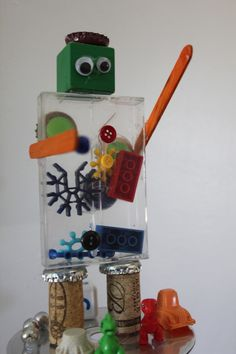 Create a small robot using recycled materials like old cds, legos, cassette tape cases. Give your robot a name. Imagine your little robot can help with chores around the house, tell us what it can do.