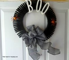 "DIY ""Boo""tiful Clothes Pin Halloween Wreath ~ An easy, frugal Halloween Craft. This could be adapted for any holiday."