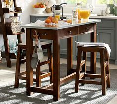 """Balboa Counter Height Table and Stools with Stainless top, in expresso mahogany or white. $899 54"""" wide x 21"""" deep x 37"""" high"""