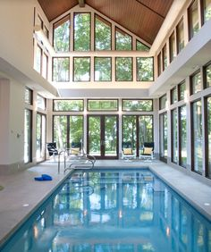 Enclosed pool with high ceilings adds elegance and light, useable all year around