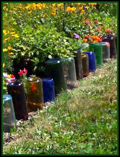 Using Glass Bottles In The Garden is part of Wine Bottle garden Borders - What can you do with wine, liquor and beer bottles in the garden Check these DIY projects using colored bottles to tickle your creative juices [LEARN MORE] Wine Bottle Garden, Glass Garden, Garden Edging, Garden Borders, Garden Path, Garden Beds, Old Wine Bottles, Recycle Bottles, Bottle Trees
