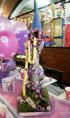 Rapunzel tower diy - paper tower rolls glued and painted, flowers, hair braid