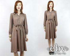 Fair/Brown Taupe Dress at https://www.etsy.com/listing/169311328/vintage-70s-taupe-flowy-secretary-day