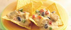 Next party, let guests scoop creamy single-serving southwest chicken nachos direct from the slow cooker. Black beans and peppers add flavor and color.