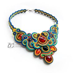 Soutache Colorful necklace. Bright and colorful soutache necklace with red crystals. MATERIALS: soutache cords, crystal beads, BACK: leather (matched the color of the product). COLOR: red, orange, yellow, gold, green, dark blue, light blue; DIMENSIONS : Inner length (neck) of necklace