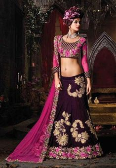 Smashing Combination Of Purple and Pink Designer Velvet Lehnga Choli Work :-Magenta Pink and Wine Purple Combination With Golden Embroidery Designer Lehnga Choli Fabric - Velvet Paired with the matching blouse piece. Lehenga Anarkali, Bollywood Lehenga, Ghagra Choli, Lehenga Choli Online, Bridal Lehenga Choli, Indian Lehenga, Bollywood Fashion, Lehenga Wedding, Bollywood Style