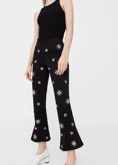 Spodnie flare z aplikacjami z koralików
