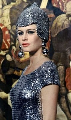 Paco Rabanne 1960s. The hat/helmet is bizarre, I love the dress though.